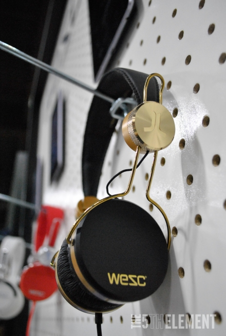 WeSC black and gold headphones