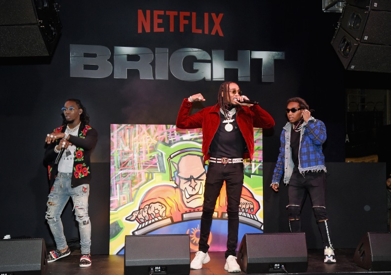 (L-R) Offset, Quavo, and Takeoff of Migos perform at the LA Premiere of Netflix Films 'BRIGHT' on December 13, 2017 in Los Angeles, California.